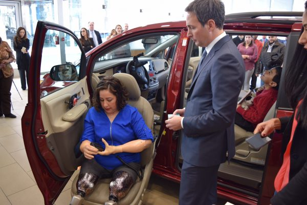 Amanda Flores Left Tries Out Features Of The Mobility Van Donated By Darcars Ceo John Darvish Right Prnewsfoto Automotive Group Bethesda