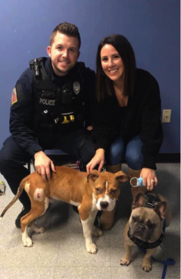 A police officer who adopted the puppy he helped rescue from abuse.(Image Courtesy: Kimberly LaRussa)
