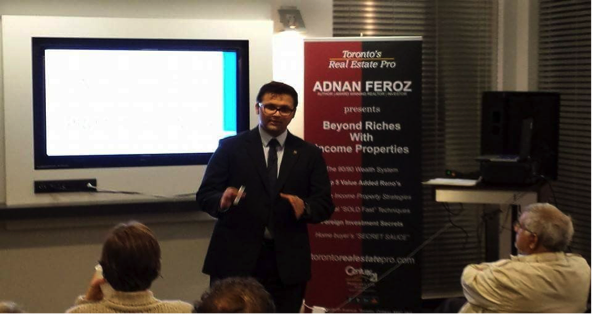 Adnan Feroz talking to his clients